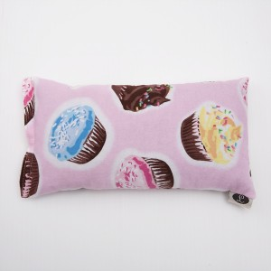 The perfect comfort for a crampy belly or lower back, a herbal heat pack in a cupcake print!