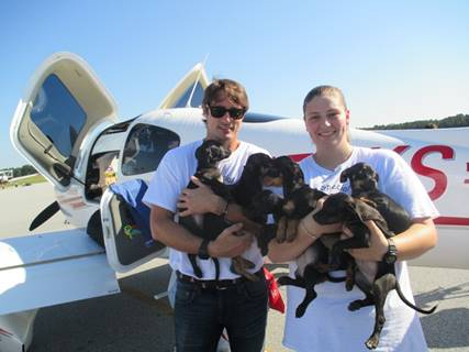 """In honor of Clear the Shelters day yesterday, Animal Aid USA rescued over 330 animals from high-kill shelters in Georgia and transported them to no-kill rescue partners in the tri-state (New York) area. You may know Prince Lorenzo Borghese (left)–of the Borghese cosmetics empire–as """"The Bachelor"""" (season nine)… except now he spends all his time saving homeless animals with his co-founder Karen Talbot (right)."""