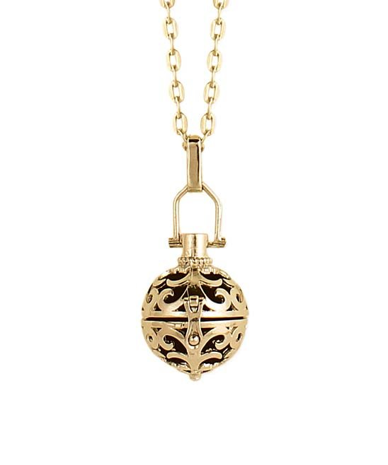 Anchoring a slender necklace, a burnished pendant carries your favorite scent. This Goldtone Cutout Diffuser Ball Locket comes in at $9.99 @zulily.com